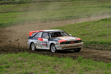 Audi rally car driving in the dirt