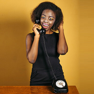 Woman smiling while picking up phone call