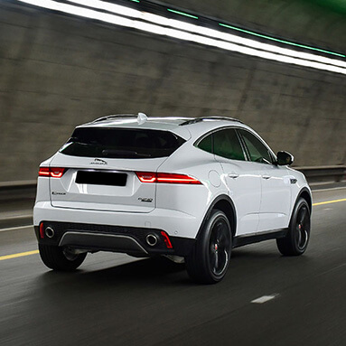 White Jaguar e-pace driving through a tunnel