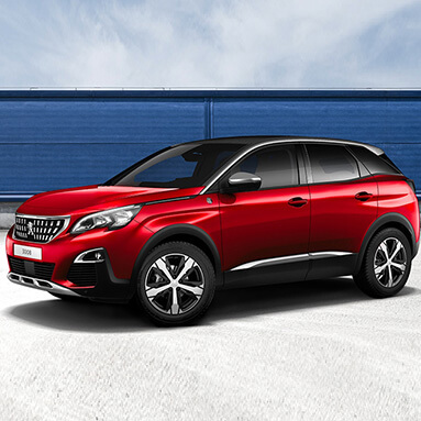 Red peugeot 2008 SUV parked sideways