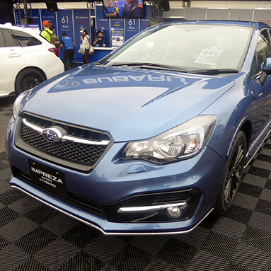 Side front view of a blue Subaru Impreza Hybrid Sport.