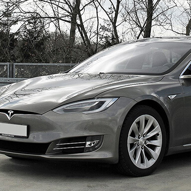 Front side view of a grey Tesla Model S.