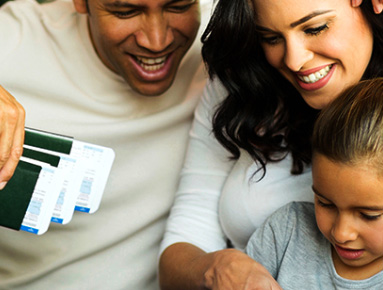 Family of 3 seated with travel tickets and passports in dads hand | Product offering | Hippo.co.za partner