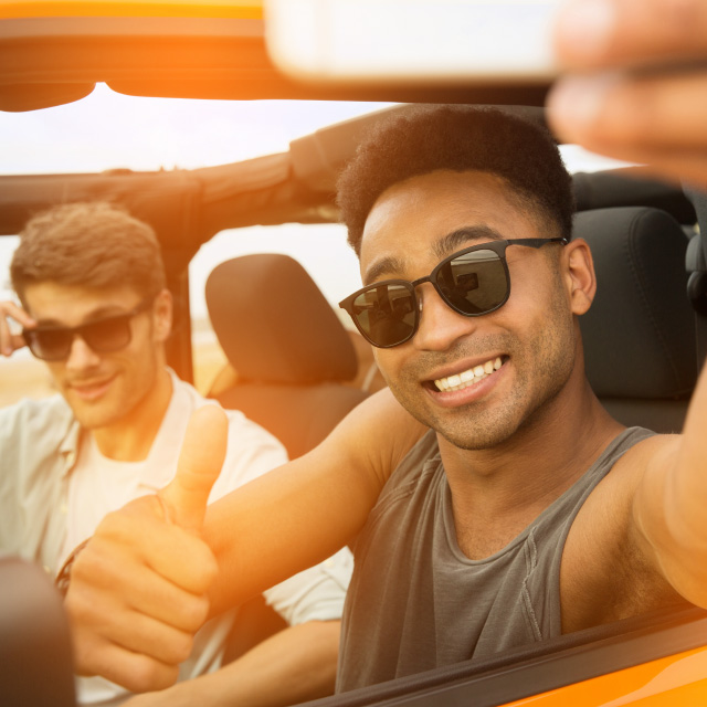Guys in car during sunset taking a selfie | Unique benefits | Hippo.co.za partner