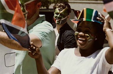 People with South African flag hat and face paint | Ons staan vir ons mense | Hippo.co.za partner