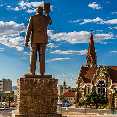 German Lutheran church in Windhoek with a statue and blue skies