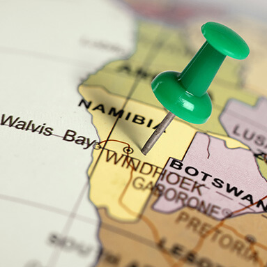Map of Namibia with green drawing pin stuck to Namibia.